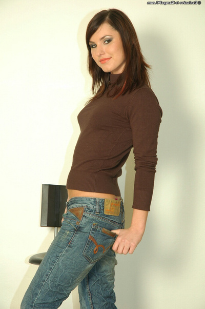 Joyous brunette good in blue jeans undressing and exposing her goods