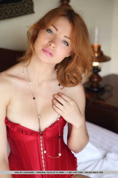 Fabulous redhead Kika displaying hairless vagina in advance of freeing biggest average meatballs