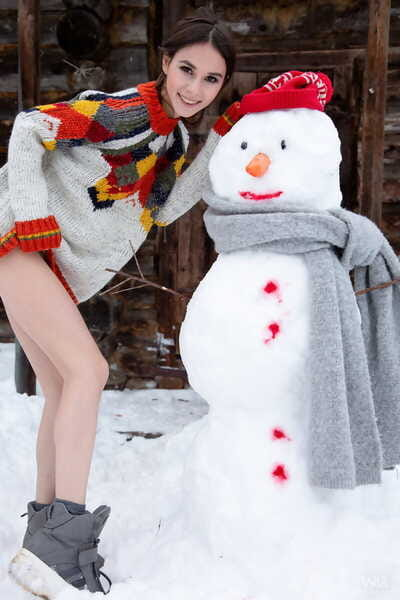 Admirable juvenile Leona Mia shows her bazookas and gentile outdoors next to a snowman