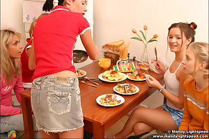 Clammy youthful gals eating and showing their happy youthful titties