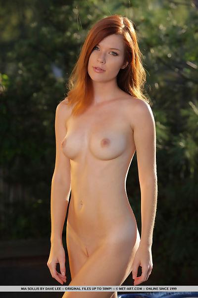Sweaty redhead Mia Sollis baring undersize meatballs & showing smooth head uterus closeup in yard