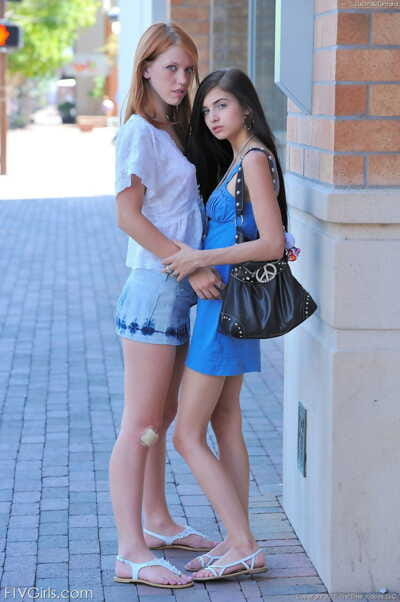 Hungry girl-on-girl queens mouth to mouth and fingering cage of love on a public street