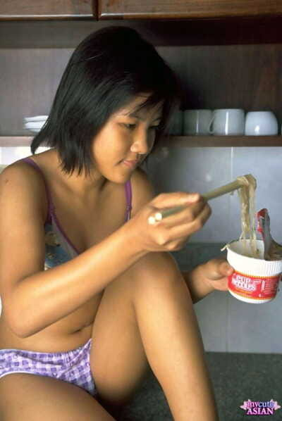 Appealing Oriental gal shows the pink of her uterus exactly after eating noodles