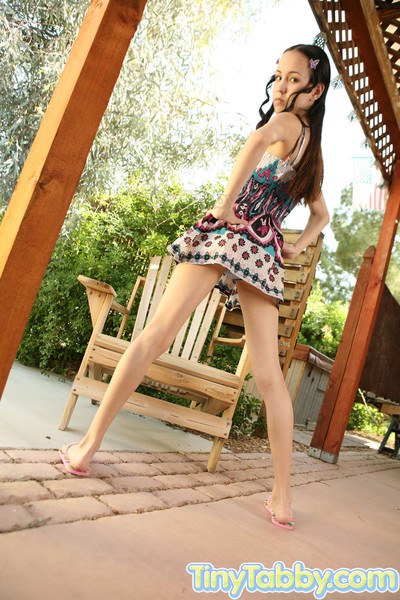 Damp amateur expands her leg on the wooden chair