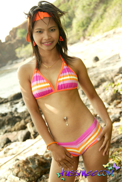 Thai dear undresses with no her bikini and benefits from topless by the sea