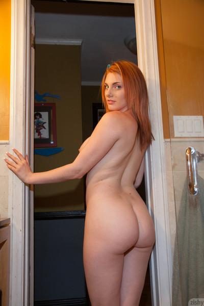Curvy redhead showering afterward gym