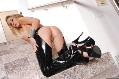 Sizzling golden-haired girl Charisma Cappelli posing in provocative latex outfit