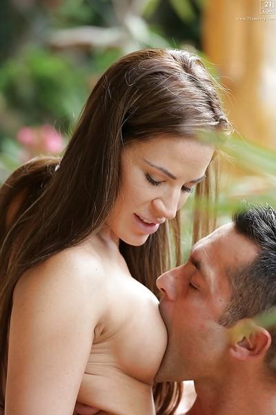 Attractive European pornstar Athina jerking phallus with barefeet outdoors