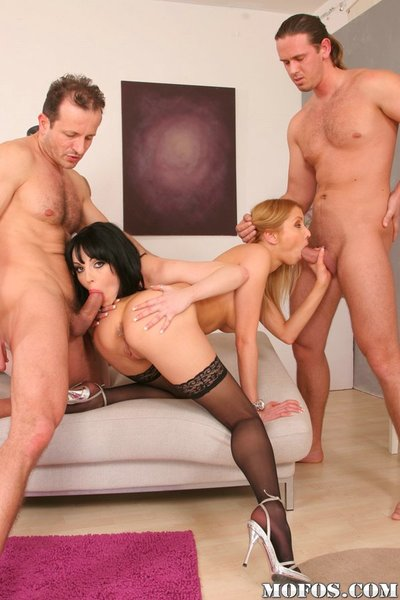 Arousing ladies with clammy bodies have fun a groupsex with well-hung boys