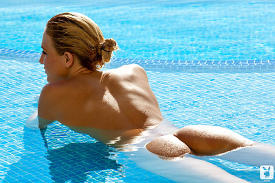 Elegant blond lass Eliza Carson showcasing her consummate body outdoor