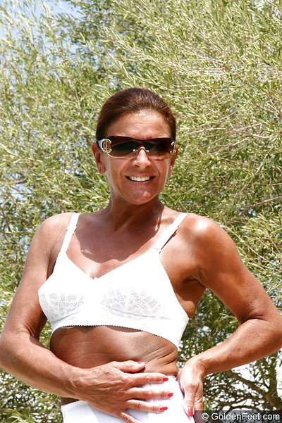 Over Fifty UK MILF Lady Sarah jacking off infiltrated slit in the woods