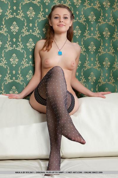 Stocking attired beauty Nikia A flaunting joyous juvenile doll meatballs