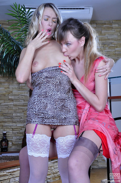 Zealous lesbian chicks in adorable nylons eat and finger their clammy uteruses