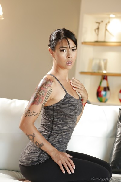 Tattooed Eastern hottie Sara Luvv is posing have benefit from a professional sample