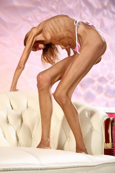 Anorexic ballerina inna on a white sofa