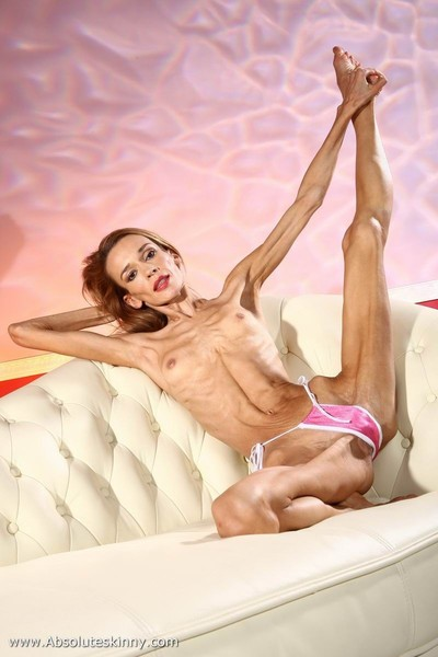 Anorexic ballerina inna on a white sofa