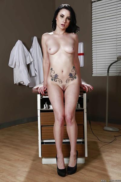 Wiry brunette hair Veruca James demonstrates her worthy tattoos!