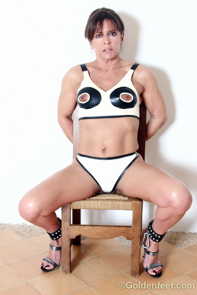 Deviant European woman Lady Sarah posing in nippleless boob coverer and cuffs