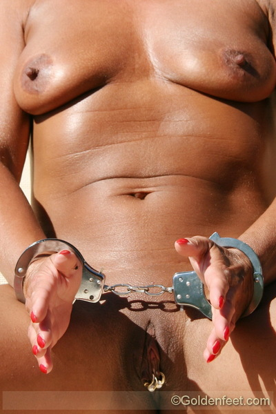 Sexual UK Bondage pornstar Lady Sarah in hairy sack gag beside swimming pool