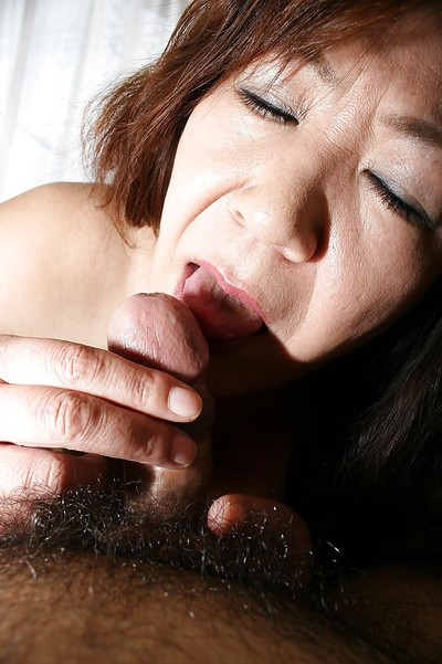 Japanese aged Michiko Okawa gives a corporeal fellatio and benefits from penetrated