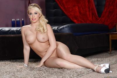 Fairy pornstar Kagney Linn Karter is posing in a red bikini outfit