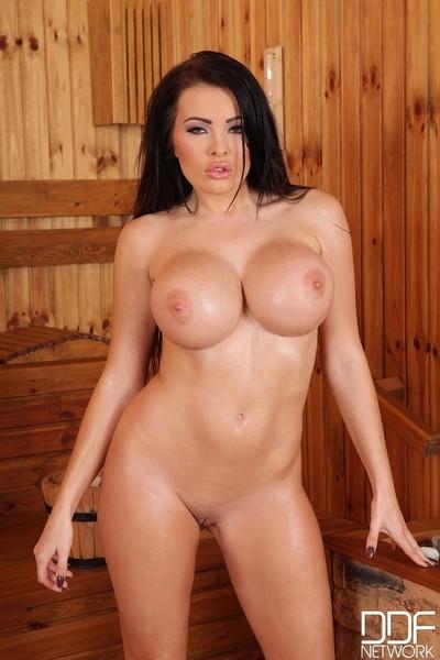 Titsy bikini dominatrix removes clothes in the sauna