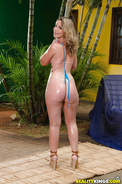 Latina chicito solo darling Flavia Oliveira posing outdoors in heels and bikini