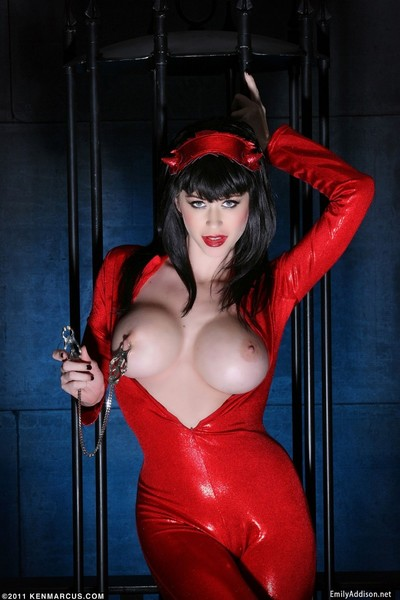 Darksome brunette hair posing in latex