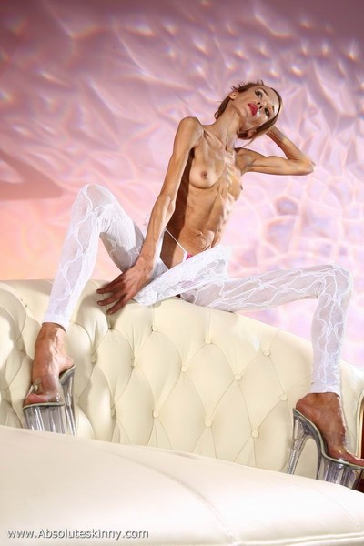 Anorexic ballerina inna on a white mattress