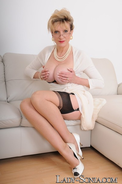 Breasty english milf in ff nylons and white heels