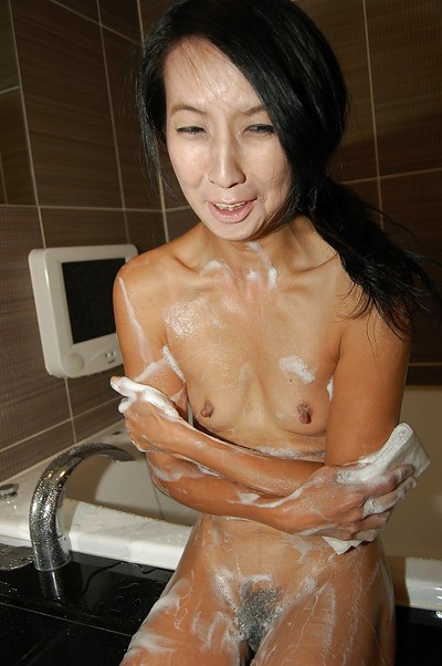 Small oriental MILF with heavy tit buttons voluptuous bath and rubbing her soapy body