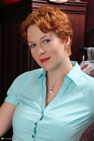 Appealing red american housewife getting energetic