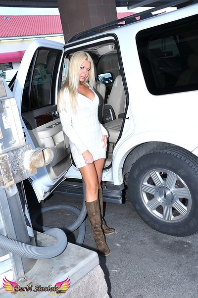 Tasteful fairy-haired MILF Barbi Sinclair shows her perfect legs in expensive white car.