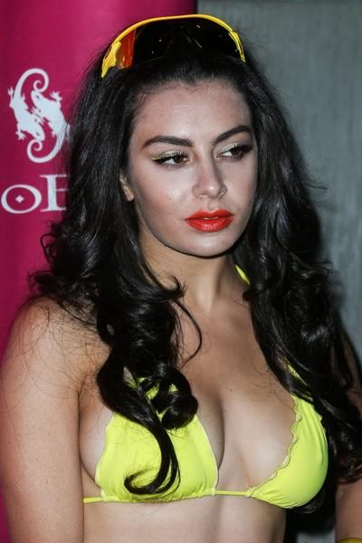 Charli xcx rounded showing boob edge pokies in yellow bikini