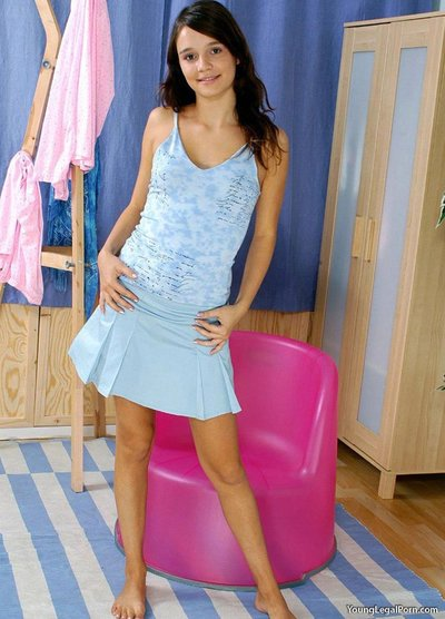 Gorgeous dark hair pulling her underclothing aside and showing pink