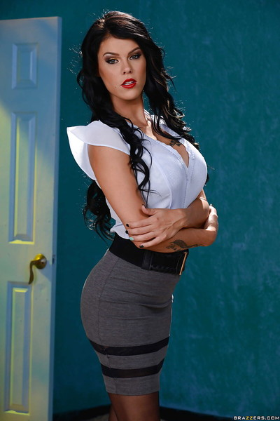 Alluring dark hair angel Peta Jensen strutting in short skirt and white blouse