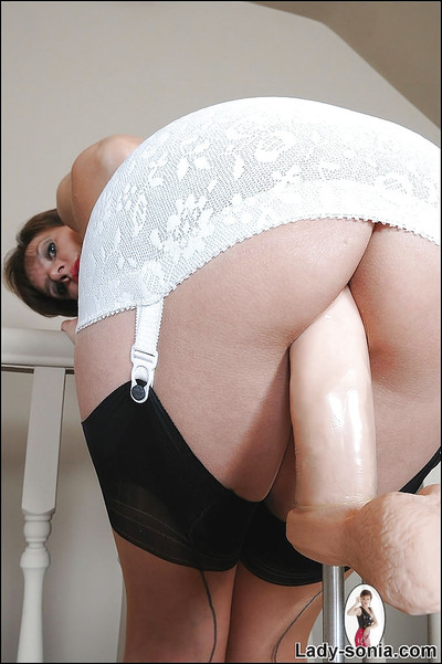 Lusty seasoned doll in nylon  riding a machine for very