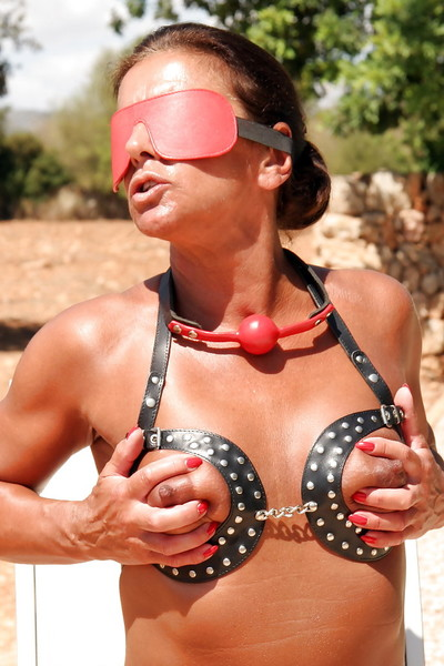 Blindfolded calm woman Lady Sarah playing with nude nipps outdoors