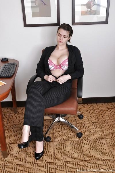 Dark brown lass exposing her large milk shakes and hirsute cunt in the office