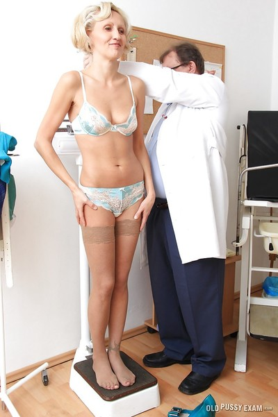 Calm blondie Sava has her cage of love shown in close up by her doctor