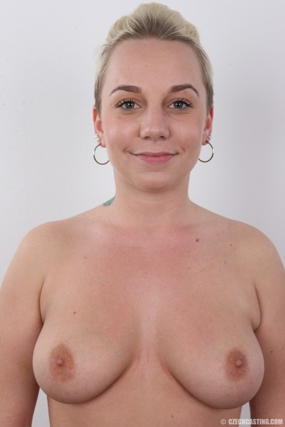 Teen dear with superior whoppers standing without clothes