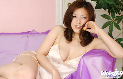Glamorous oriental beauty with hawt legs uncovering her insignificant wobblers