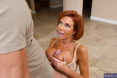 Perspired redhead cougar seduces and copulates a fellow for some palatable cum