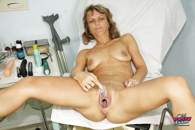 Lean full-grown lady with flaccid meatballs purchases her slit examed by gyno