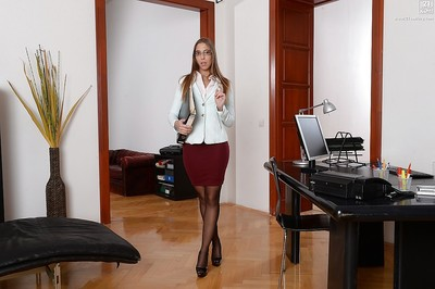 Perspired office darling Suzie Moss is a appealing darling in short skirt and hose