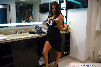 Curvy model Brook Ultra positions in brown  and high heels in kitchen