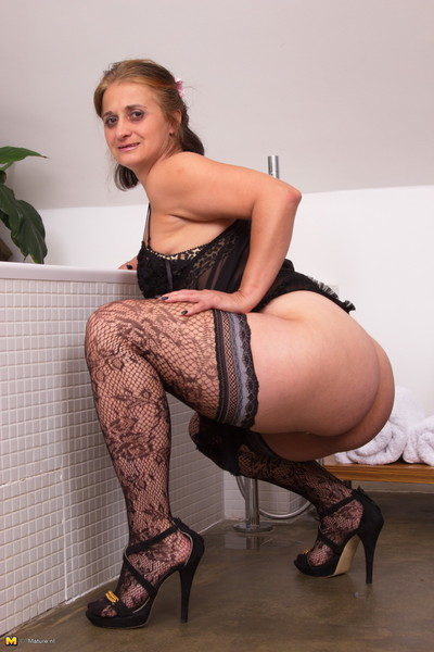 Bawdy housewife captivating a washroom