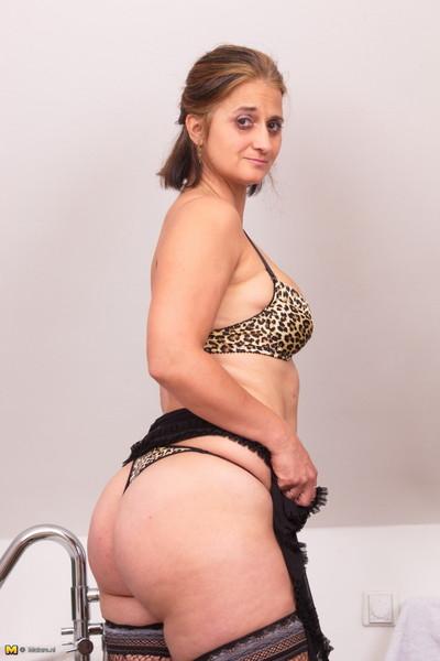 Bawdy housewife captivating a washroom