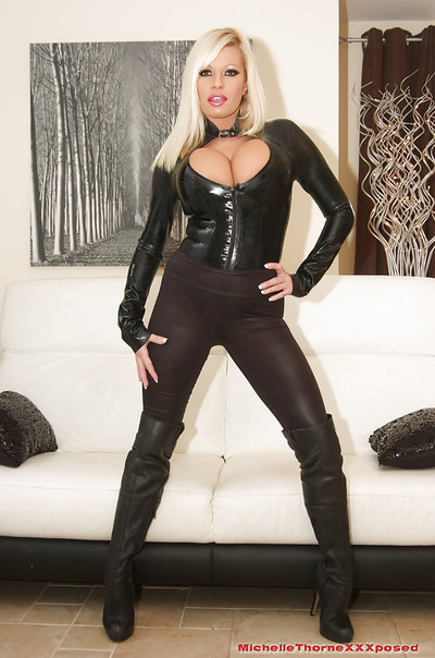 Fabulous blondie Michelle Thorne is posing in her rigid latex outfit