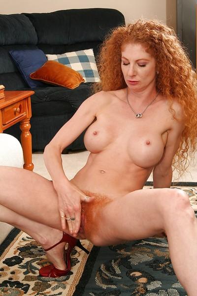 Redhead svelte MILF with bushy vagina gobbles and jazzes a vast ebony equipment